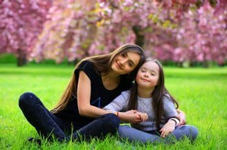 child girl with her mother in happy mood